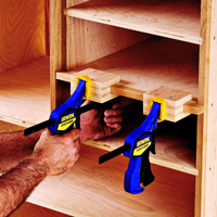 Man clamping inside of box with blue clamps