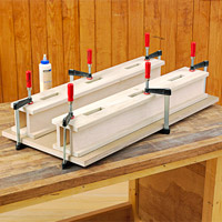 Two boxes with lots of clamps