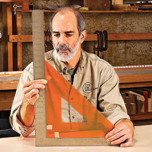 Man with orange triangle and metal square