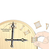 Clock with self adhesive numerals