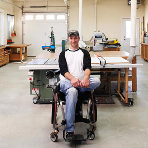 Man in wheel chair in shop