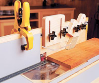 Yellow clamp on board, jig with 4 knobs