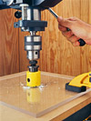 Clamp your insert-plate blank and a backer board to your drill-press table