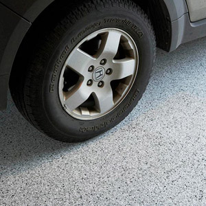 Section of floor with car wheel on it