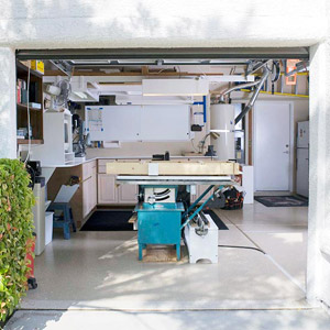 One garage door open showing tablesaw