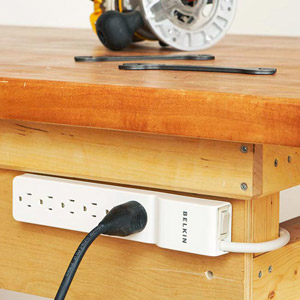 Electrical outlet under top of workbench