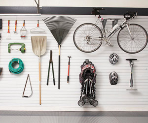 Wall full of tools, bike, helmets, rack. Etc.
