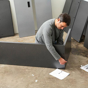 Man working with corner piece , white papers on floor
