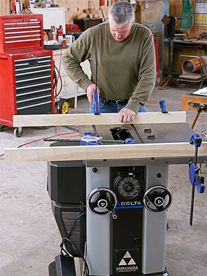 Man clamping boards to tablesaw