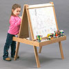 Little girl and young artist's easel