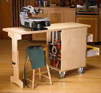 work bench with green cloth on chair