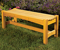 Garden bench with purple flowers