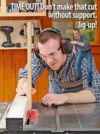 Man at tablesaw with little guy by his ear