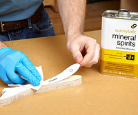 Wiping paper with mineral spirits