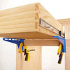 Clamps under drawer