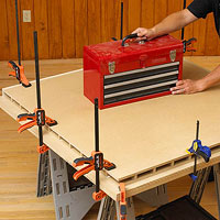 Red toolbox on boards