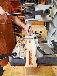Mortise jig with holes in board