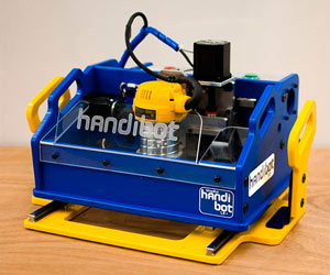 Handibot machine in blue case