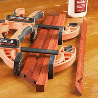 Orange clamp with 3 boards