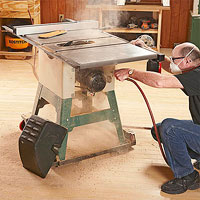 Man at dusty tablesaw