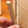 Putting small strip of wood into glued spot