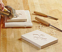 Hand carving board and Fleur-de-lis image on board