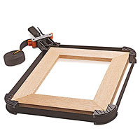 Picture frame in clamps