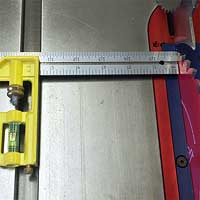 Metal ruler with liquid level on tablesaw