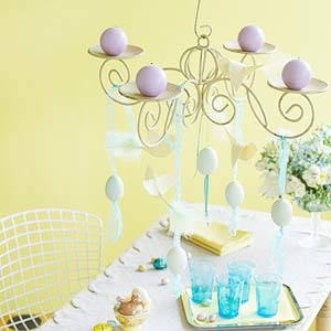 chair, table, tray with blue glasses, low hanging chandelier