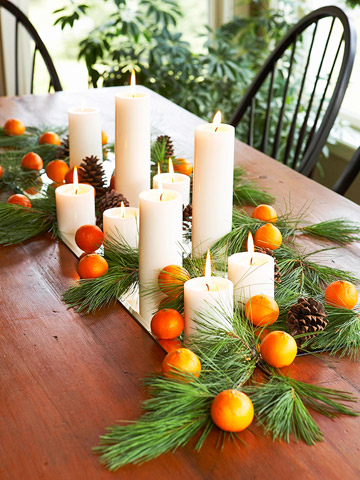 White candles & oranges on table
