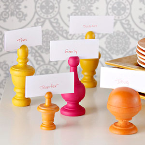 Painted finials as place card holders for tabletop
