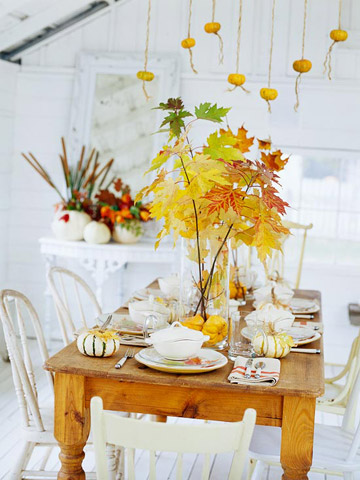 Leaves in vases on farmhouse table