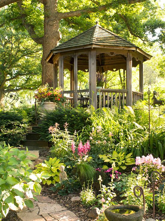 A shade garden leading to a gazebo.