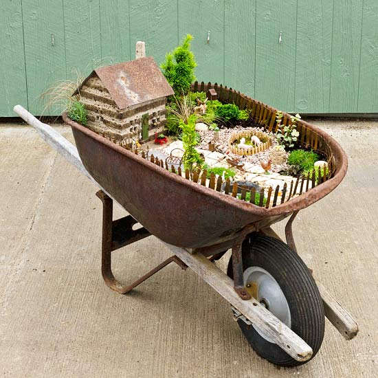 Plant up a wheelbarrow fairy garden for Fairy garden box ideas