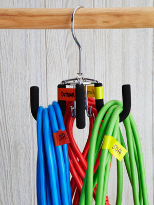 Drape a cord from each hook of a rotating tie-and-belt hanger. Tag cords  with colored electrical tape.