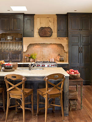 distressed black cabinets add a bit of yesteryear charm in a kitchen that u0027s both thoroughly modern and timeless in style  the faux aged cabinet surfaces     black kitchen cabinets  rh   bhg com