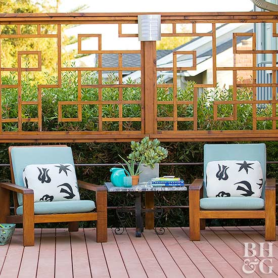 wo light blue cushioned chairs in front of upper railing wood design on deck - Deck Railing Design Ideas