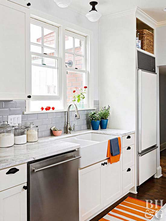 White Beveled Subway Tile Kitchen With A Focal Point