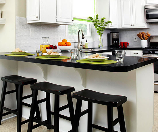 Black countertops can take any kitchen from bland to bold. At home in both traditional and contemporary kitchens black counters pair best with white or ... & Black Kitchen Countertops | Better Homes u0026 Gardens