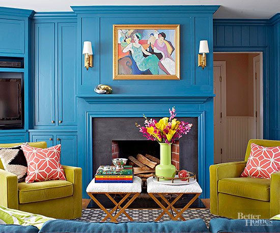 The Bold Peacock Walls In This Living Room Provide The Perfect Backdrop For  A Pair Of Chartreuse Club Chairs. By Painting The Trim The Same Color As  The ...