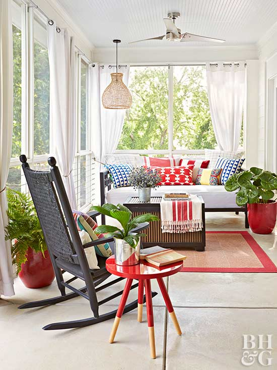 Red, white, and blue decorated covered porch with rocking chair and outdoor furniture. #porch #outdoordecor #countrystyle #redwhiteblue #americana #summerstyle
