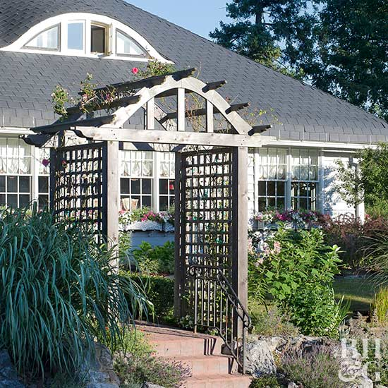 Designed To Straddle The Walkway At Top Of Steps This Arched Construction Converts A Trellis With Addition Square Lattice Panels