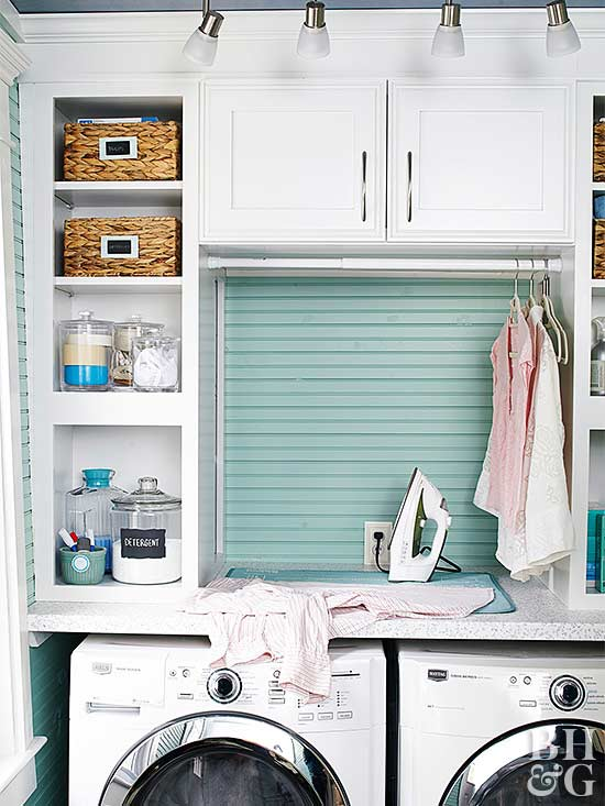 One of the benefits of a small laundry room is that it's easy to hide  unsightly items from view. Look to laundry room cabinets to stash your  iron, ...