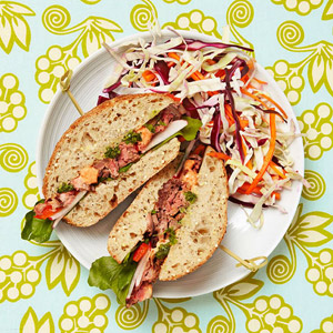 Steak Sandwich With Red-Pepper and Pesto Sauces and Slaw