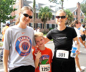 Jacki running road race with family